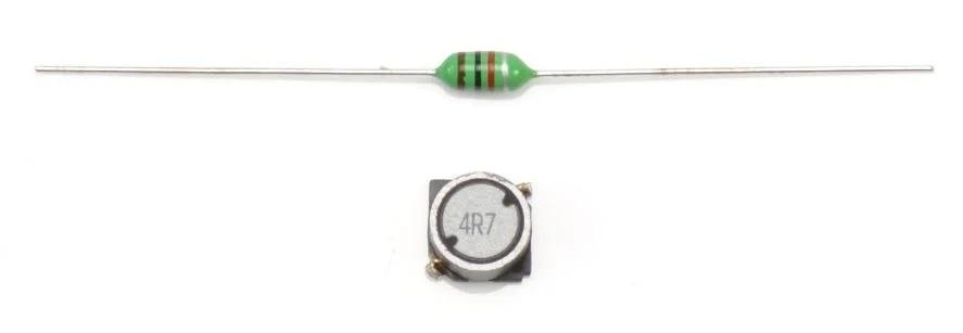 Внизу дроссель большой мощности, вверху малая катушка в корпусе, похожем на резистор.
